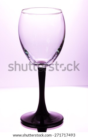 Wine glass on a lilac background with a gradient - stock photo