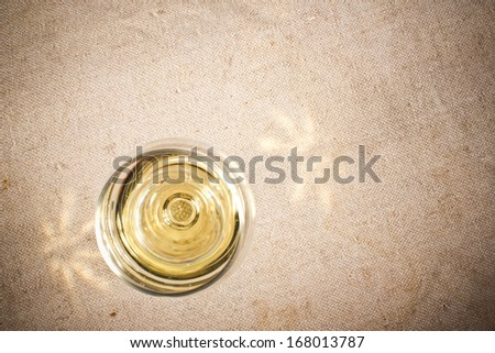 Wine glass on pattern fabric. View from top texture - stock photo