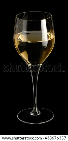 wine glass partly filled with white wine in black back - stock photo