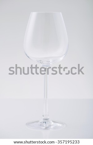 Wine glass. Picture of wine glass standing on white surface. - stock photo