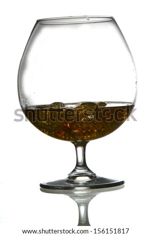 Wine glass with whiskey - stock photo