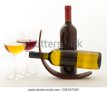 wine glasses and bottles wine an unusual angle on white background - stock photo