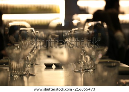 Wine glasses defocused in bar and restaurant and blurred background - stock photo