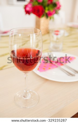 wine glasses filled with red wine on the table at the restaurant  - stock photo