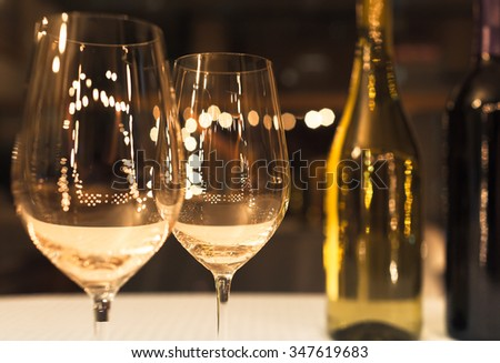 Wine glasses in a fine dinning setting - stock photo
