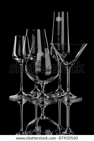 Wine glasses of different profile on a black background - stock photo
