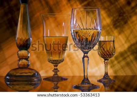 Wine glasses on orange grunge background - stock photo