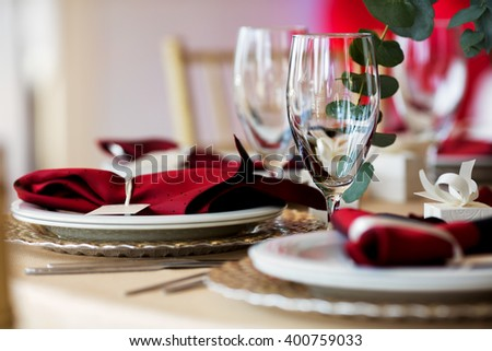 Wine glasses on table with other eating utensil - stock photo