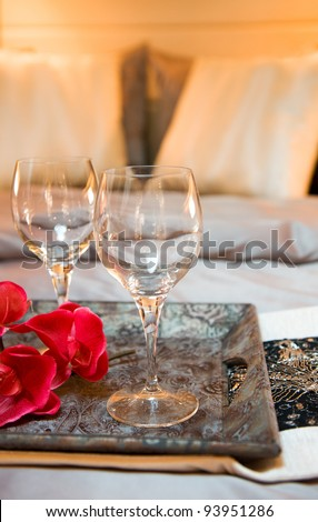 wine glasses on tea-tray in the bed of a luxury yacht. - stock photo