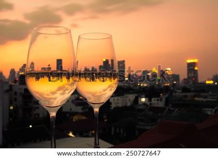 Wine glasses with city view - stock photo