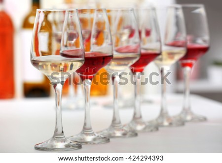 Wine glasses with red and white wine, closeup - stock photo