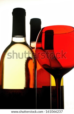Wine glassware background design made from a wine glass and bottles. - stock photo