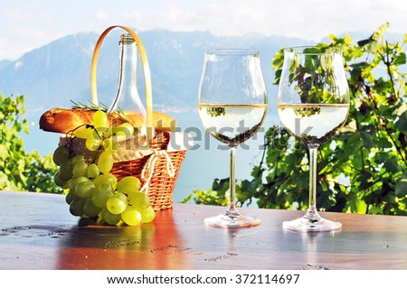 Wine, grapes and bread against Geneva lake, Lavaux region, Switzerland - stock photo