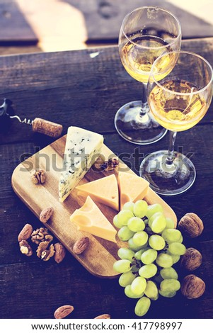 Wine, grapes, nuts, cheese, blue cheese. Dinner, lunch, romantic date, picnic, eating on nature. - stock photo
