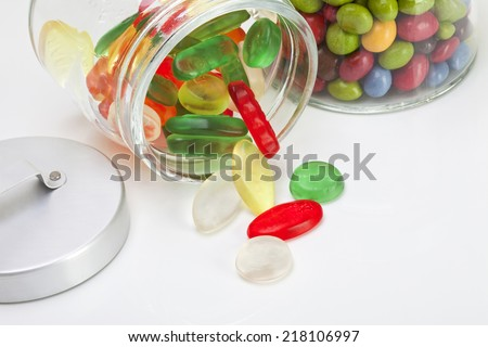 Wine gums and Smarties in candy jar, close up - stock photo