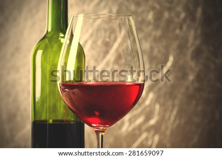 Wine in glass and bottle. instagram image filter retro style - stock photo