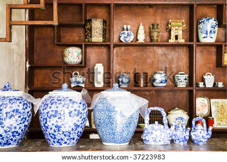 wine jars lined up inside a drinkery in China. - stock photo