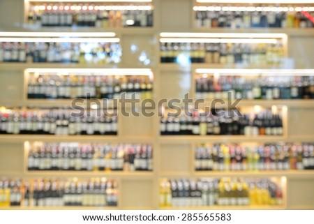 Wine Liquor bottle on shelf, Blurred Bar Restaurant background - stock photo