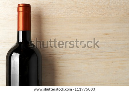Wine List Design Series: Bottle of red wine over wooden banner - stock photo