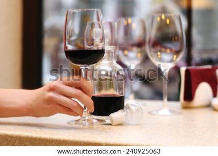 Wine tasting in bar - stock photo