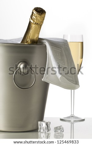 Wine with bucket and glass of white wine isolated on white background - stock photo
