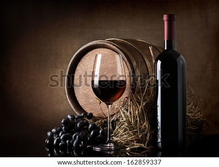 Wine with wooden barrel, hay and grape - stock photo