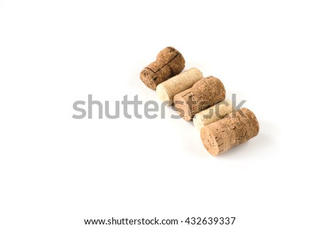 Wine wooden cork on white backrgound. From alcohol beverage. Vintage brown winery object. Natural texture.  - stock photo
