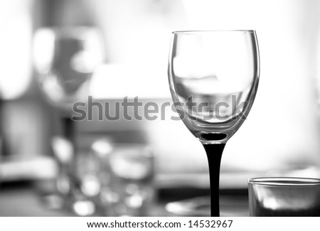 Wineglass against blurry background. Shallow DOF. Black and white tone. - stock photo