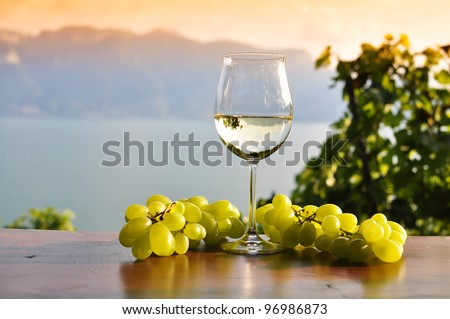 Wineglass and bunch of grapes. Lavaux region, Switzerland - stock photo