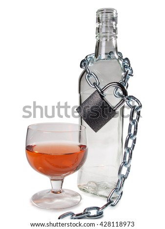 Wineglass of whiskey and metal chain n white background        - stock photo
