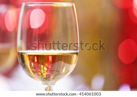 Wineglass on blurred lights background - stock photo