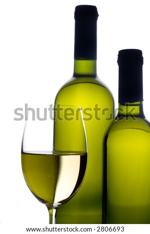 Wineglass with two wine bottles - stock photo