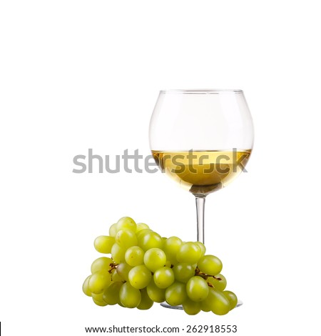 wineglass with white wine and grape over white - stock photo