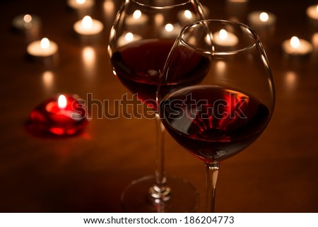 Wineglasses in candlelight - stock photo