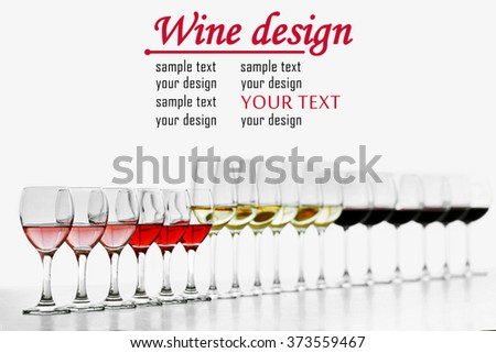 Wineglasses with white, red and pink wine on wooden table - stock photo