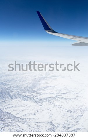 Wing aircraft in the sky under earth of  snow Russia - stock photo
