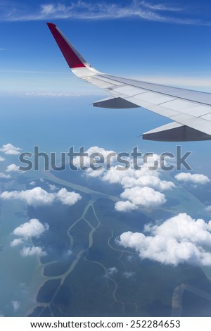 Wing aircraft in the sky under earth of Thailand  - stock photo