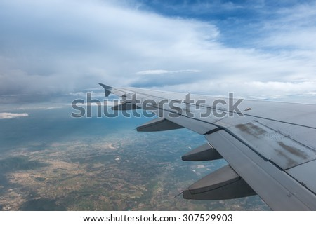 Wing airplane over the sky while flying - stock photo