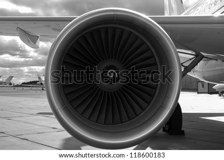 Wing and jet engine jet airliner black and white - stock photo