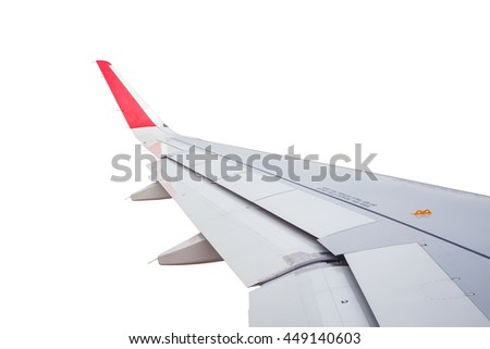 Wing of airplane flying on white background - stock photo