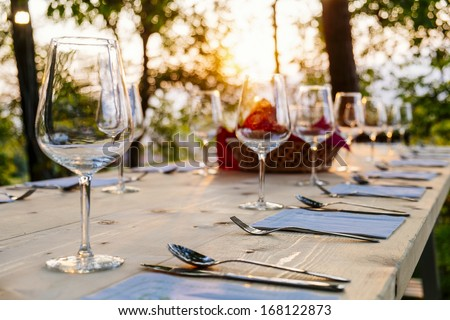 wingalsses on a settle table outdoor - stock photo
