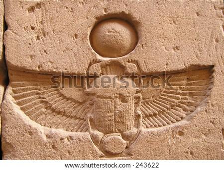 winged scarab beetle carved on top of door of Edfu temple. Egypt - stock photo