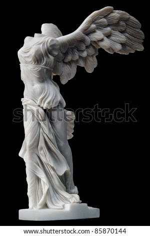 winged victory of samothrace small replica isolated on black background - stock photo