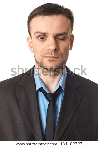 Winking businessman portrait on white - stock photo