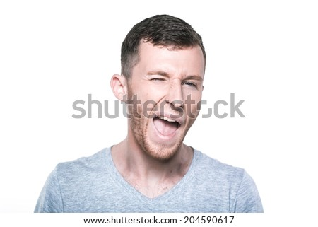 Winking man - stock photo
