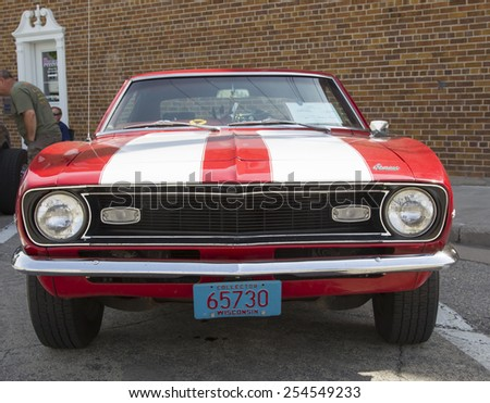 WINNECONNE, WI - JUNE 7:  Front of 1968 Red and Whtie Chevy Camaro at Winneconne Annual Car Show Public Event June 7, 2014 in Winneconne, Wisconsin. - stock photo