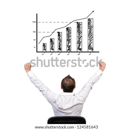 winner businessman looking at chart of profit - stock photo