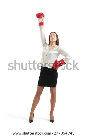 winner businesswoman in formal wear and red gloves raising one hand up and looking with confidence at camera. isolated on white background - stock photo