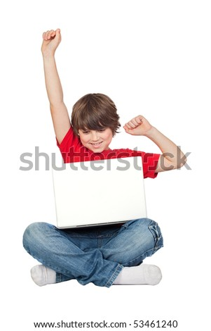Winner little boy sitting with laptop isolated on white. - stock photo