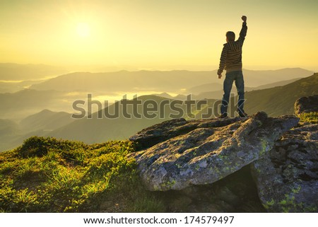 Winner on the mountain top. Sport and active life concept - stock photo